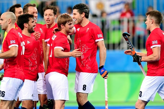 Ashley Jackson congratulated by his Great Britain teammates after scoring at the Rio 2016 Olympics