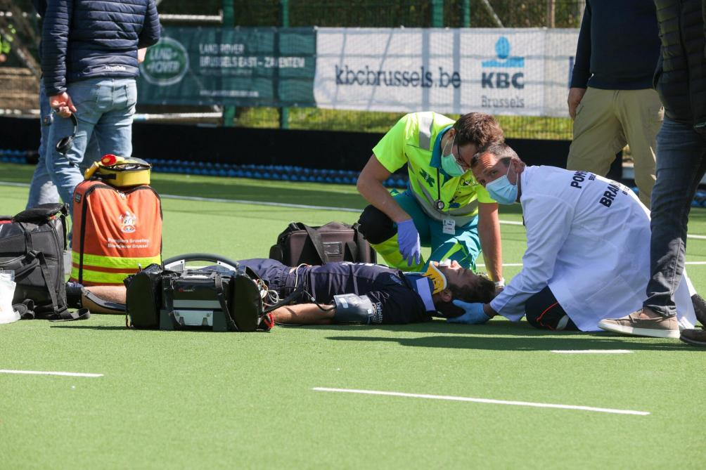 Royal Orée's Manu Stockbroekx receiving emergency first aid after collision with Max Lootens